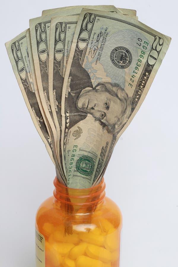 Pillen en dollarrekeningen royalty-vrije stock afbeeldingen
