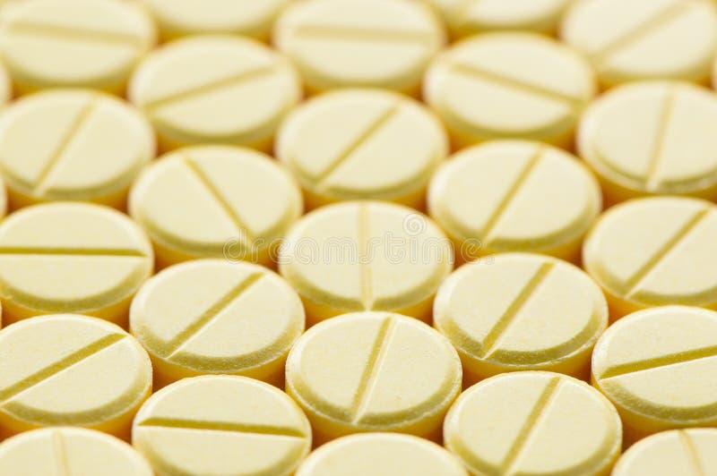 Pillen op een rij stock fotografie