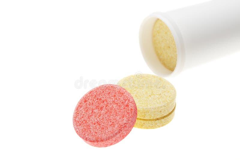 Pillen op witte achtergrond stock foto's