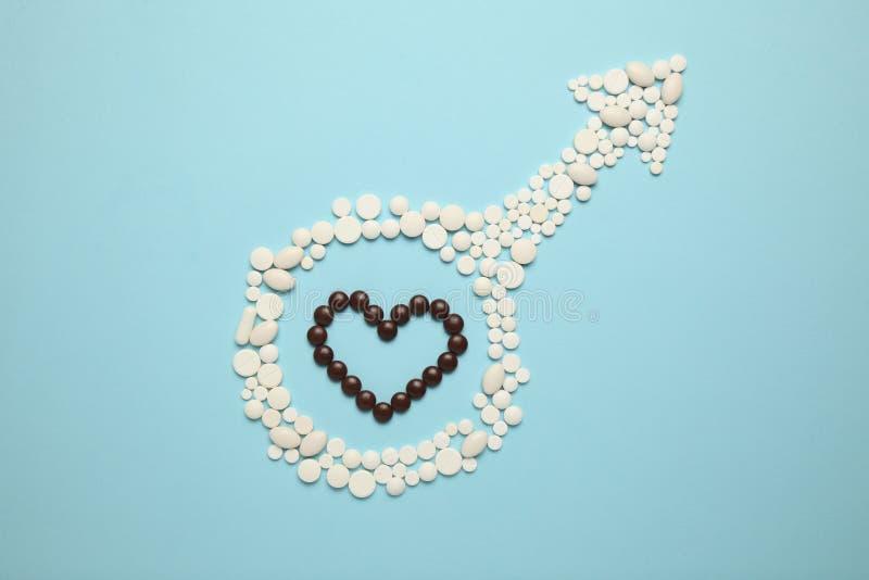 Pillen in symbool van mannetje Mannelijk seksueel dysfunctieconcept Leeftijdsprobleem van kracht stock afbeeldingen
