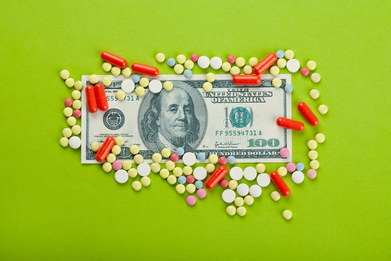 Pillen und Dollar stockbilder