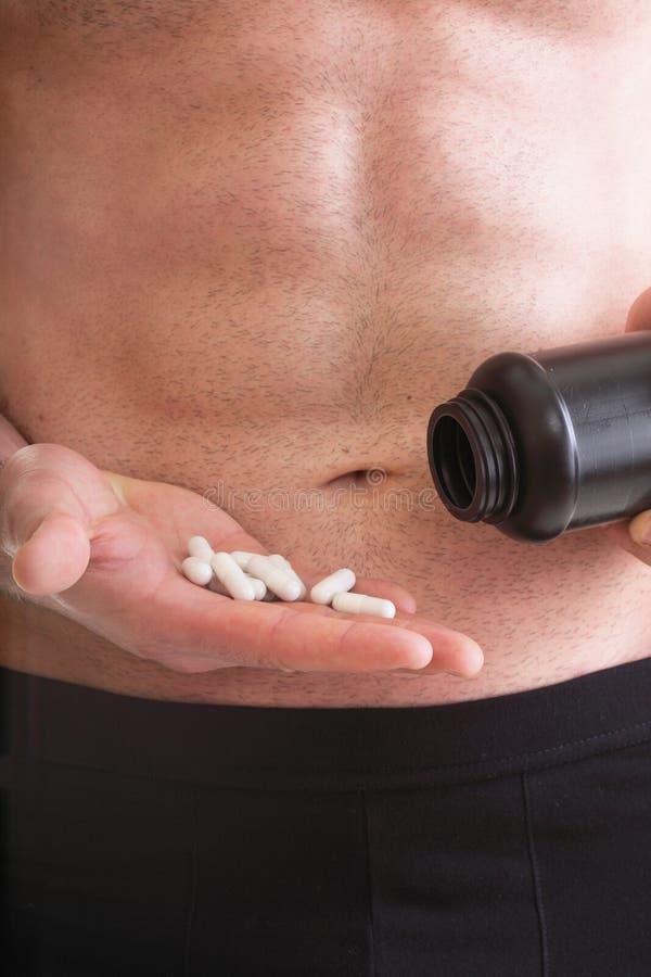 Pillenwiderstandtablette packt lokalisierten Ergänzungen Mann ein stockbild