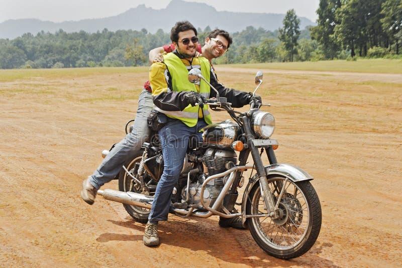 Pillion mounts motorcycle leg over royalty free stock image