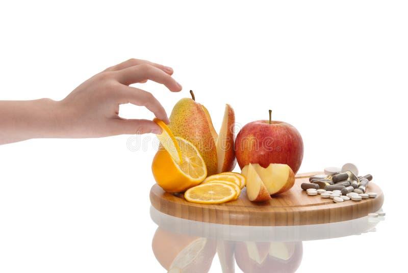 Pillola Choice delle vitamine della frutta fotografia stock libera da diritti