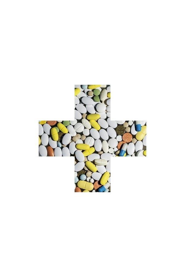 Pillole colorate per il trattamento delle malattie e della tossicodipendenza sotto forma di incrocio medico fotografie stock
