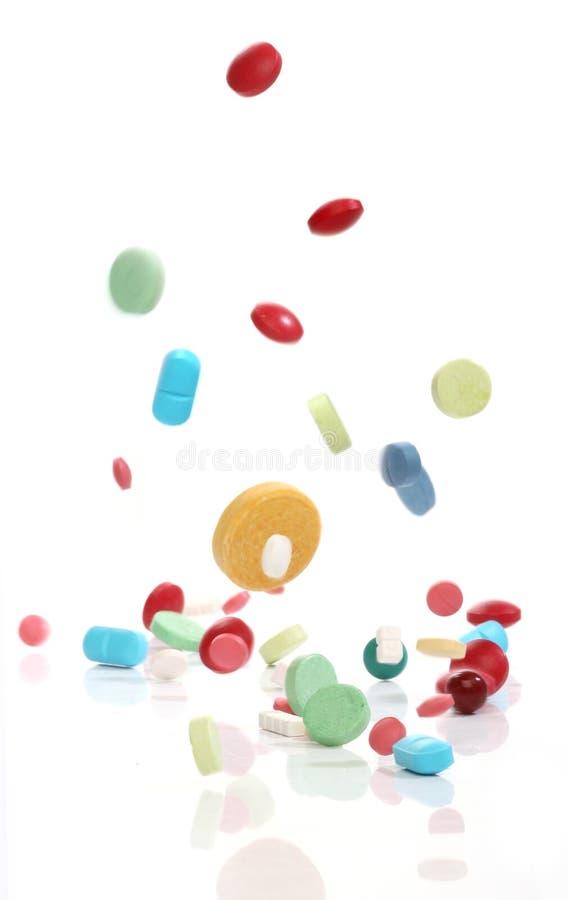 Pillole di caduta della medicina immagine stock libera da diritti