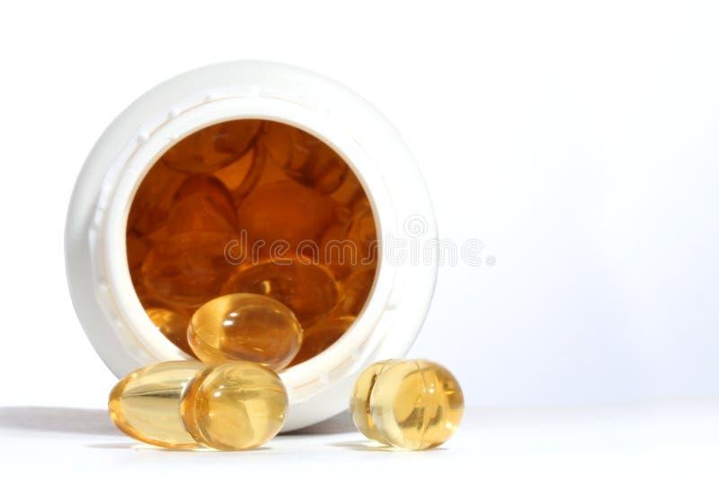 Pillole e bottiglia fotografia stock