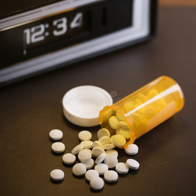 Pillole rovesciate immagine stock