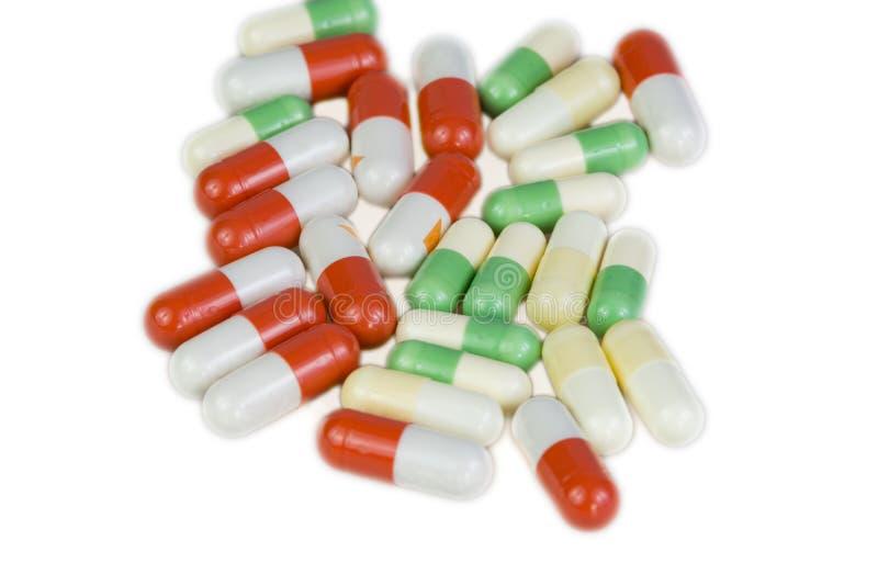 Pillole su fondo bianco immagini stock