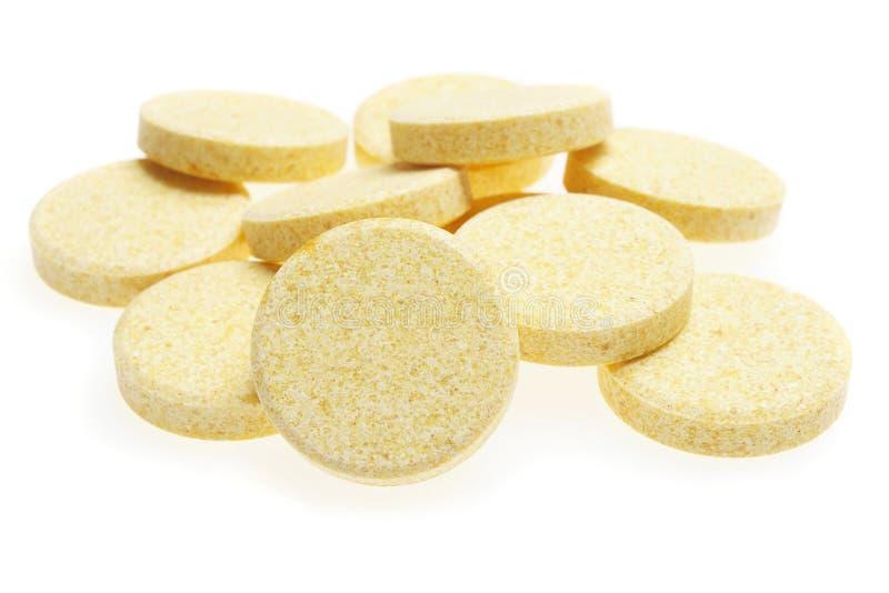 Pillole su priorità bassa bianca immagine stock libera da diritti