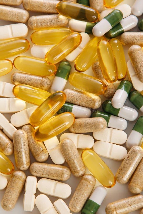 Pillole variopinte differenti fotografia stock
