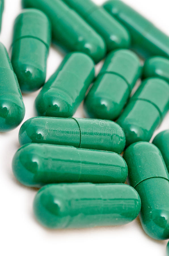 Pillole verdi immagini stock