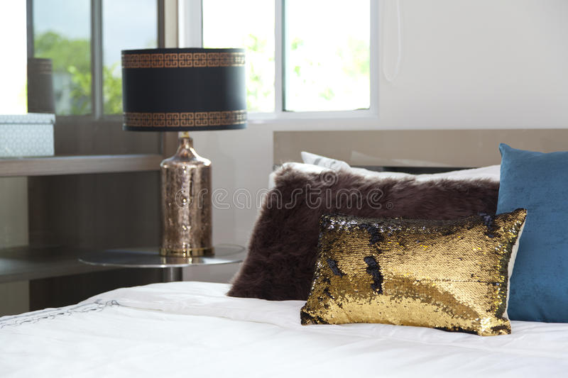 Pillow on a bed in bedroom. Luxury gold pillow on a bed in bedroom royalty free stock image