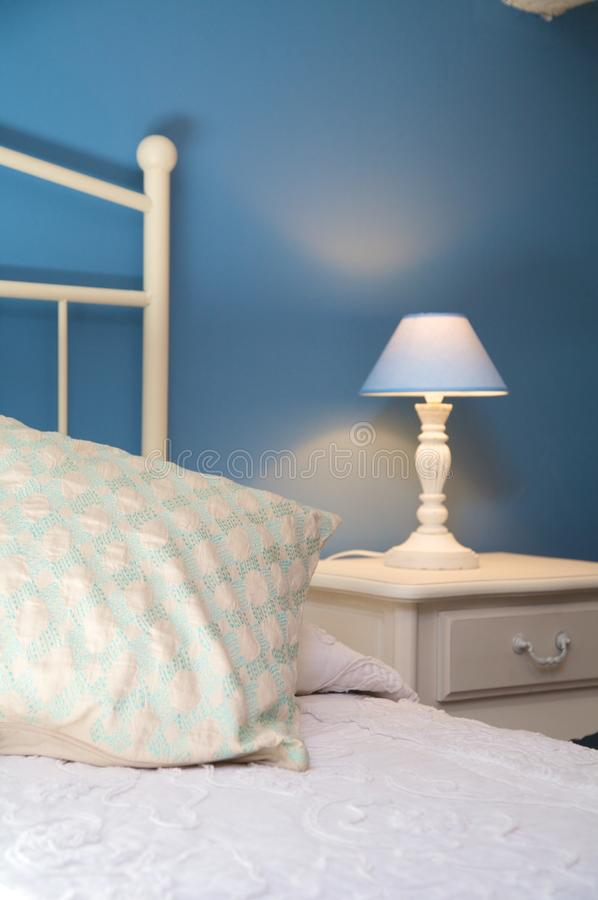 Pillow and bedside table. Detail of pillow and bolster of a bed royalty free stock photography