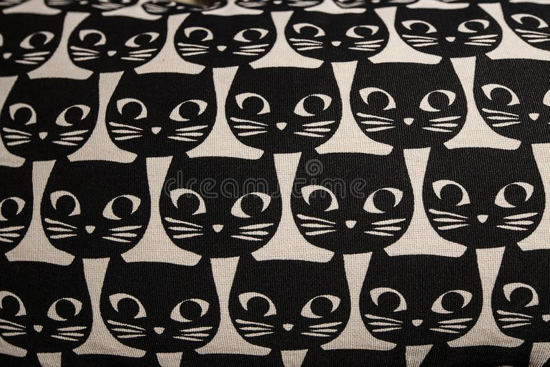 Cat head cartoon pattern. Pillow with black cat head cartoon pattern royalty free stock image
