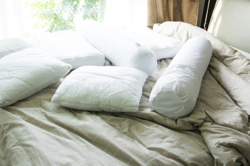 Pillow with bolster on bed. Close up pillow with bolster on bed royalty free stock images