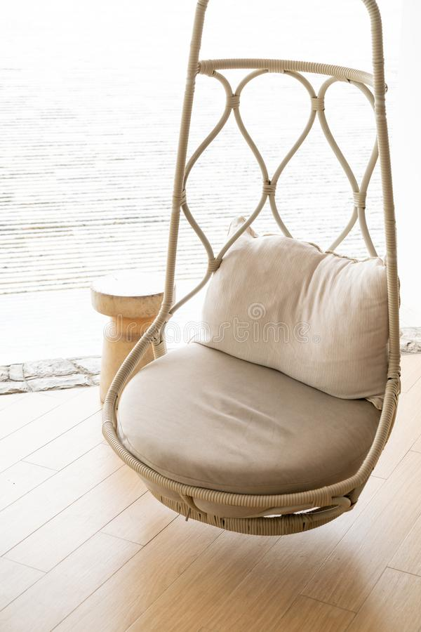 Pillow on patio chair in hotel resort. For relax stock photo