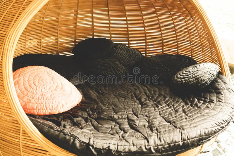 Pillow on patio chair in hotel resort. For relax stock photos
