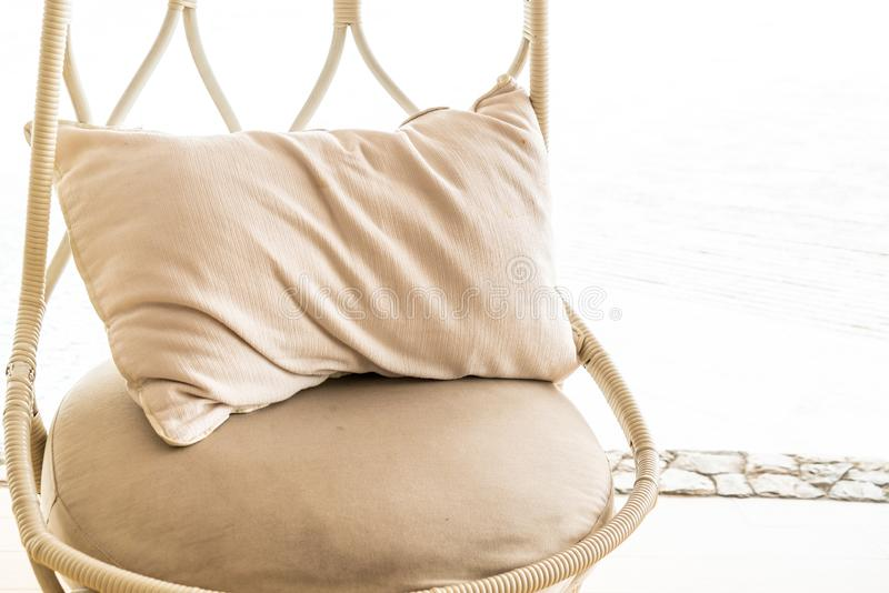 Pillow on patio chair in hotel resort. For relax royalty free stock image