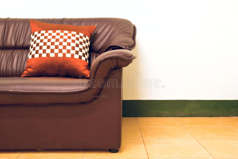 Pillow on a sofa. A pillow on a brown sofa in the rest room stock photos