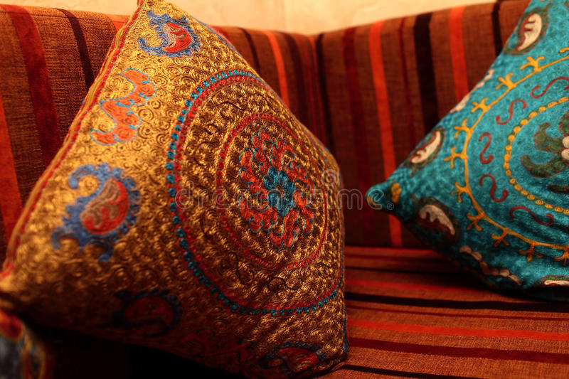 Pillows on the couch. In the uzbek restaurant stock photos