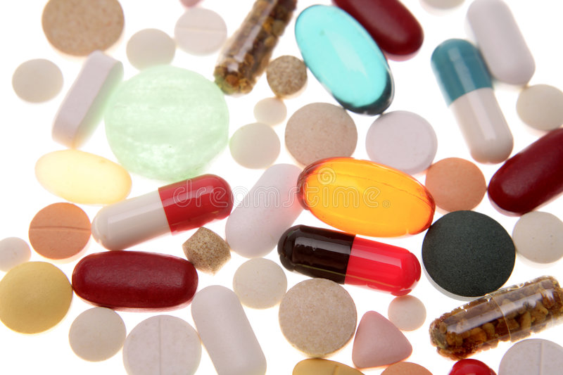Pills. Assorted pills and capsules on white royalty free stock photography