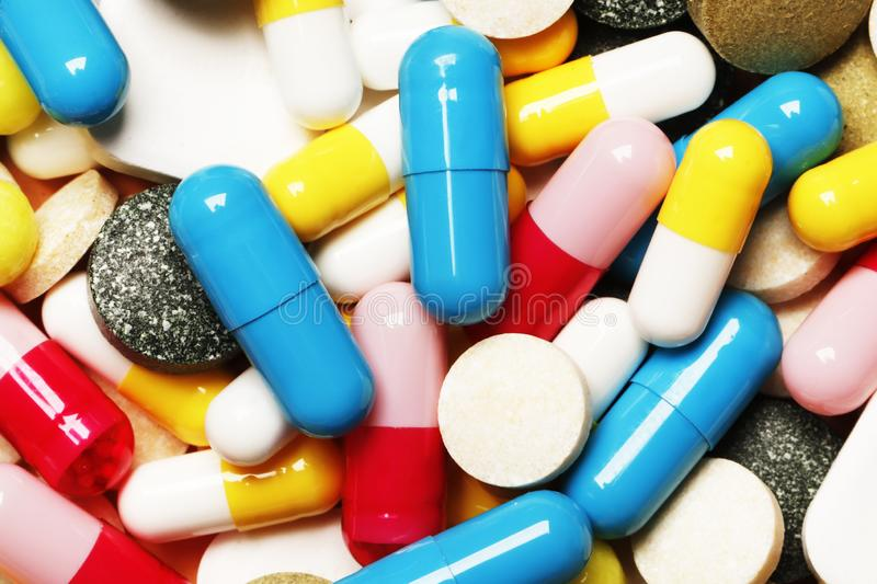 Pills as a background. Vitamins and antibiotics. stock images