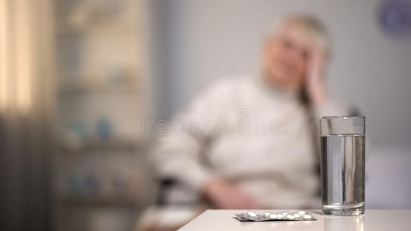 Pills blaster and glass of water on table, pharmaceutical industry, medication. Stock photo royalty free stock photos