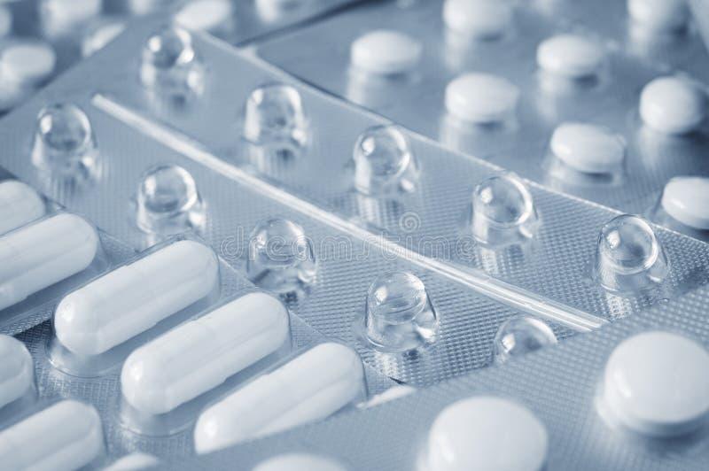 Pills in blister pack closeup stock photos