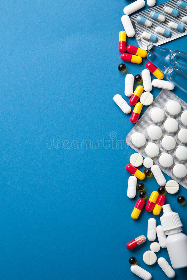 Pills Border Over Blue Stock Photo. Image Of Hospital