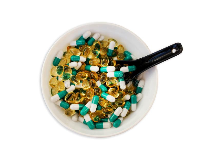 Pills in bowl, dietary nutritional supplements. stock photography