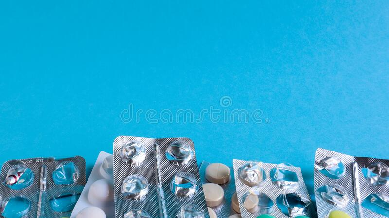 Pills, capsules with medicine, vitamins in the package, in blister packs are on the table. antibiotics, multicolor antibacterial. Drugs. Healthcare and medicine royalty free stock photo