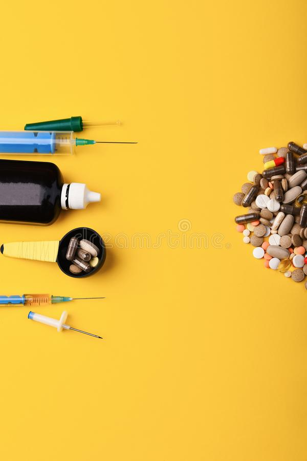 Pills and capsules put in half circle. Set of tablets. Pills and capsules put in half circle. Set of colorful tablets on yellow background, copy space. Medical royalty free stock photo