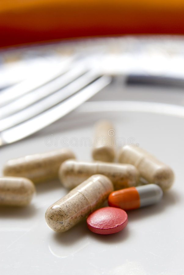 Pills on dish stock photos