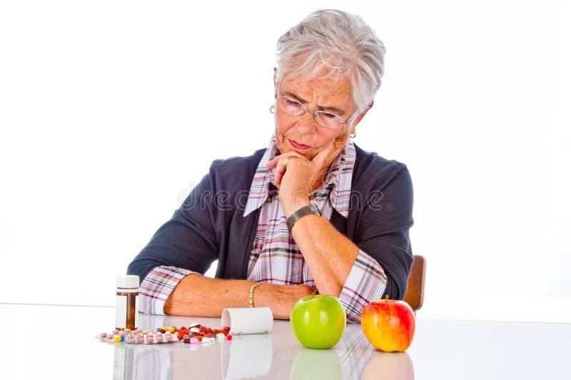 Pills eller vitamin arkivfoto