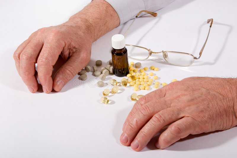 Pills And Hands Stock Photo