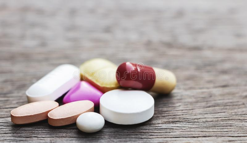 Pills or medicine on wood table. The drug is needed to treat the disease.  stock photos