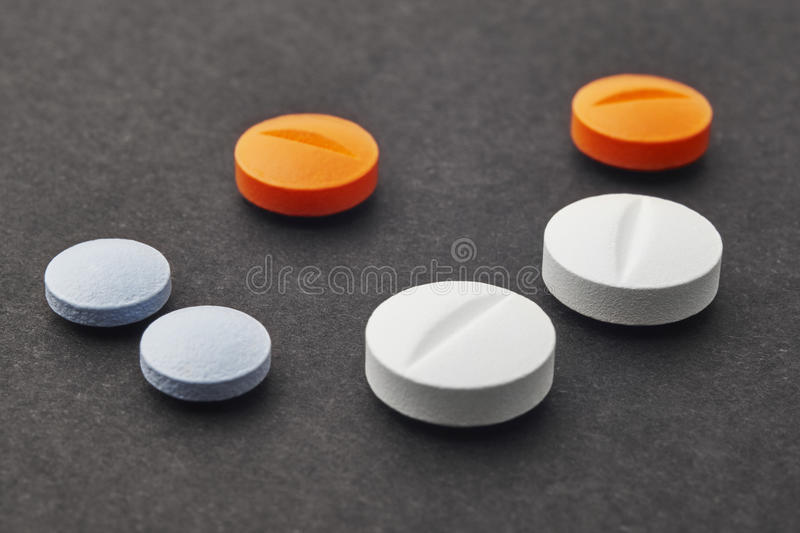 Pills over a black background. Medicament treatment. Health care. Photo royalty free stock photos