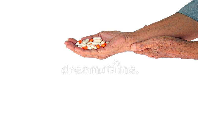 pills in senior woman hand royalty free stock photos