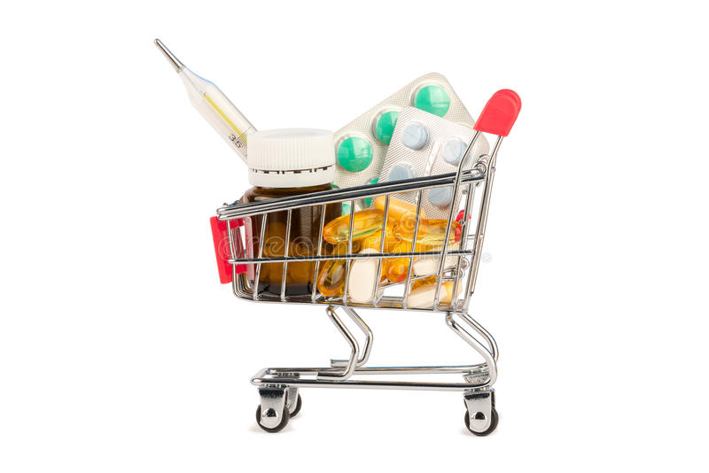 Pills in shopping cart stock images
