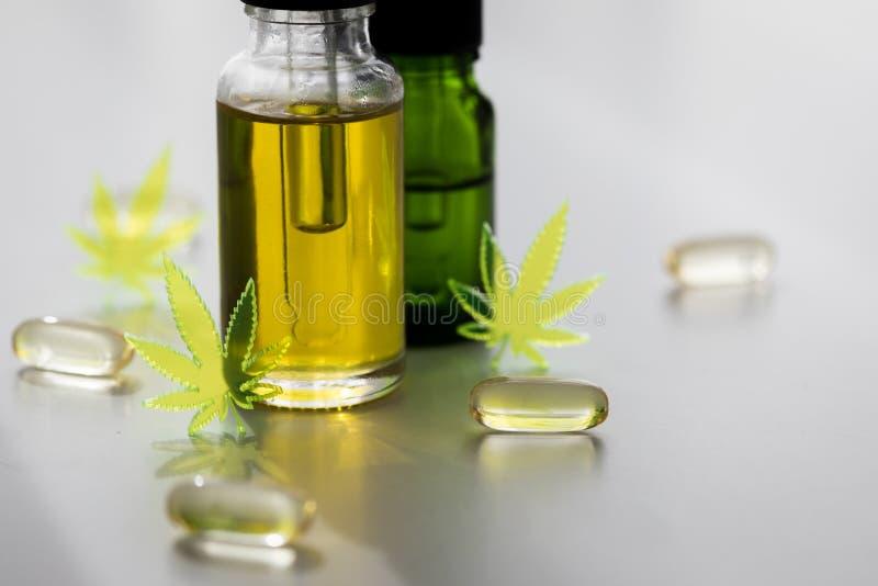 Pills, tablets,  capsules and oil of cannabis marijuana hemp and CBD as pain killer and medical royalty free stock image
