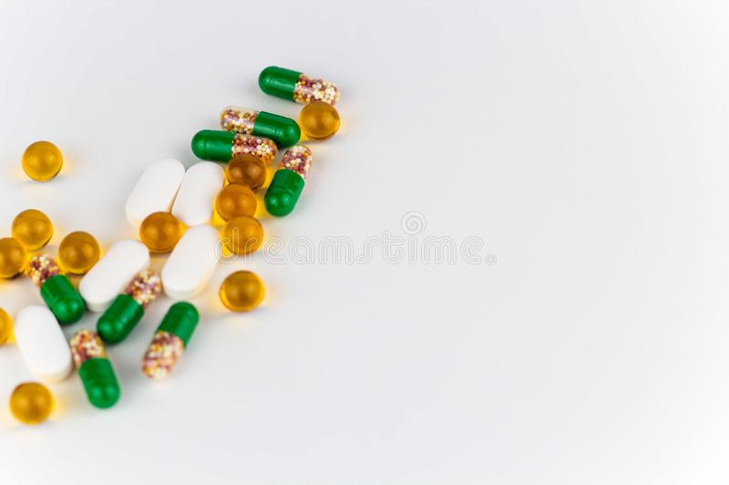 Pills and vitamins. Mess white background copy space stock photography