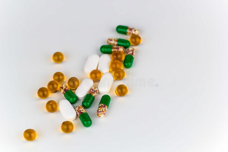 Pills and vitamins. Mess white background copy space stock photos