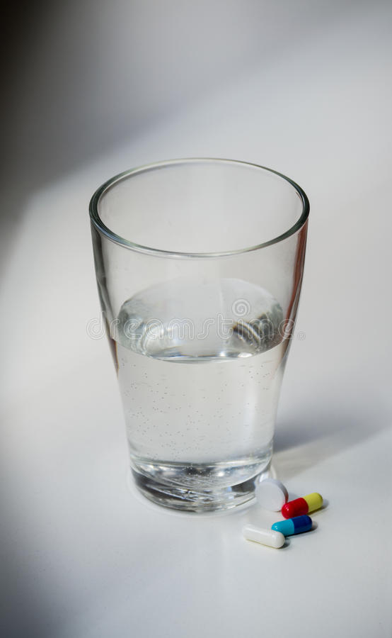 Pills and water royalty free stock photography