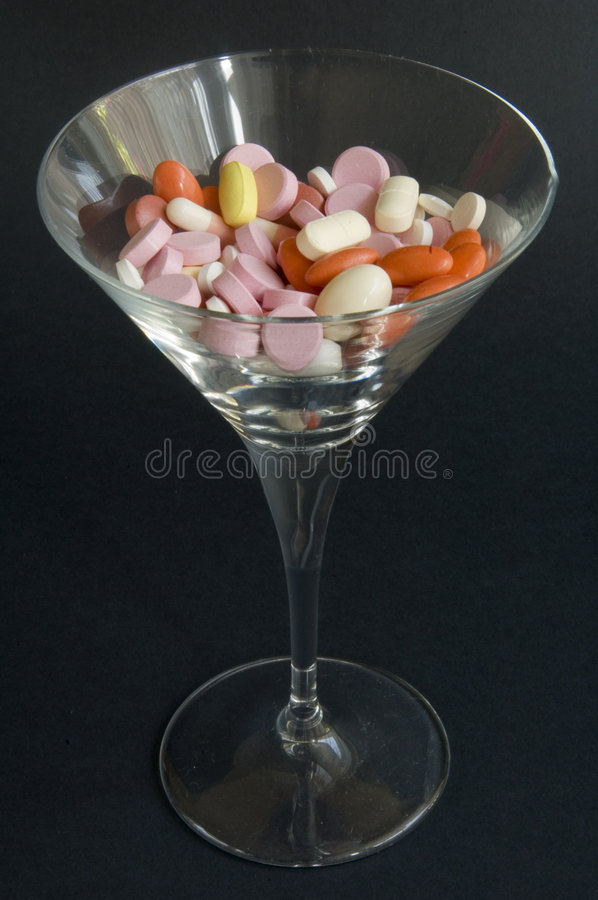 Pills and wine royalty free stock images