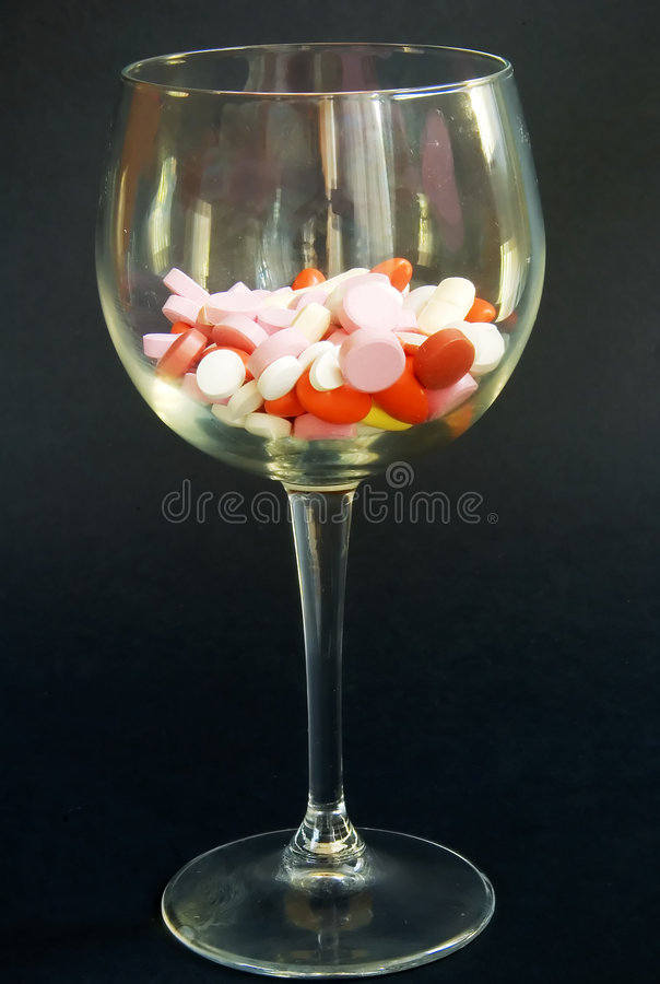 Pills and wine royalty free stock photos