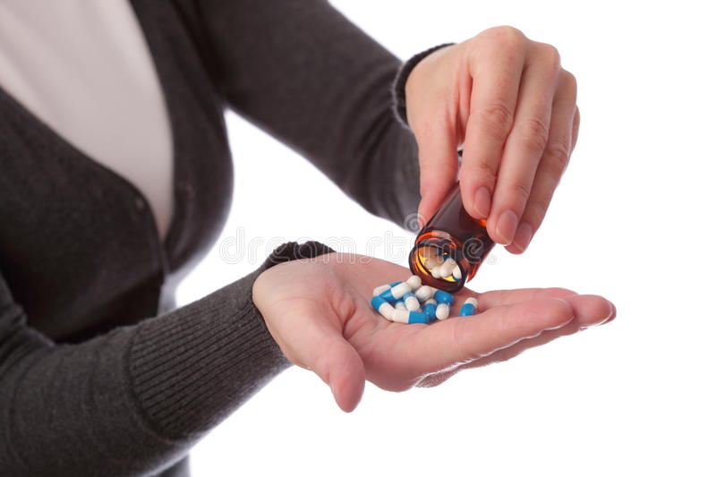 Pills in woman hand royalty free stock image