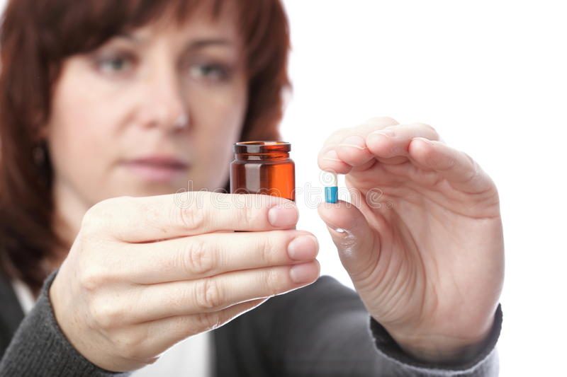 Pills in woman hand royalty free stock photo