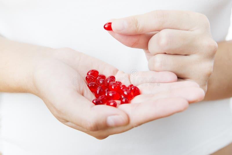 Pills in women hands royalty free stock photo