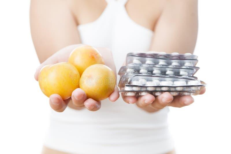 Pills in women hands royalty free stock image